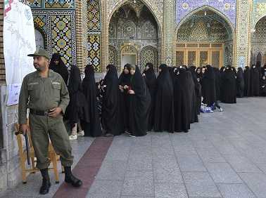 Female voters queue at a polling station for the presidential election in the city of Qom, Iran. AP