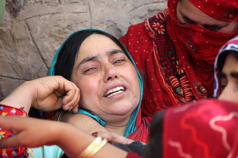 Ummer Fayaz's mother at the funeral of her son