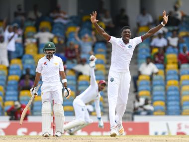 Babar Azam (L) of Pakistan dismissed by Alzarri Joseph (R) of West Indies. AFP
