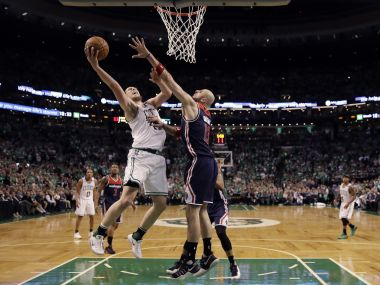 Boston Celtics center Kelly Olynyk (41) drives against Washington Wizards players during Game 7. AP