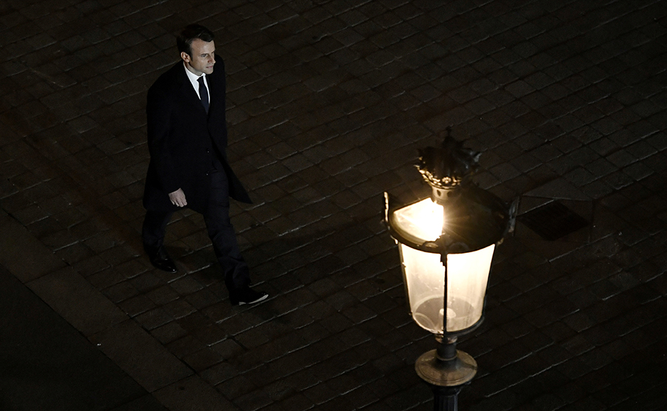 French president-elect Emmanuel Macron arrives to deliver a speech at the Pyramid at the Louvre Museum in Paris on May 7, 2017, after the second round of the French presidential election. Emmanuel Macron was elected French president on May 7, 2017 in a resounding victory over far-right Front National (FN - National Front) rival after a deeply divisive campaign, initial estimates showed. / AFP PHOTO / POOL / PHILIPPE LOPEZ