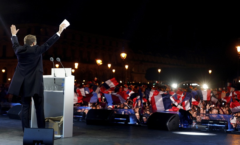 French president-elect Emmanuel Macron celebrates on stage at his victory rally near the Louvre. AP