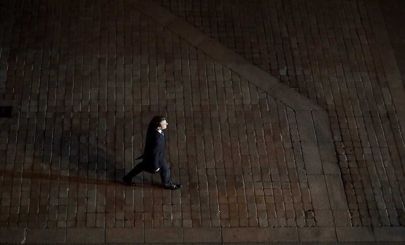 Incoming French president Emmanuel Macron walks towards the stage to address his supporters at the Louvre in Paris. AP