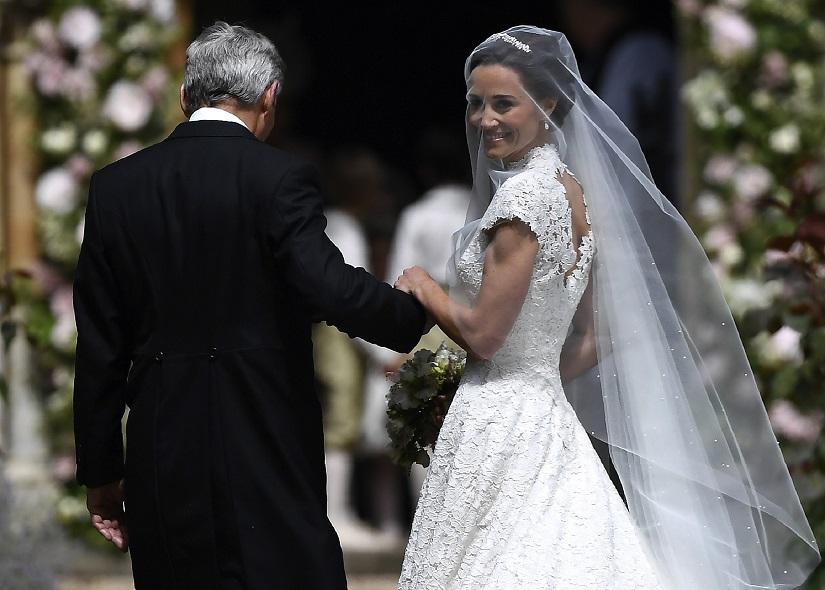 Giles Deacon crafts Pippa's custom wedding dress
