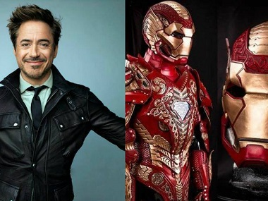 Robert Downey Jr and the current Iron Man costume. Twitter