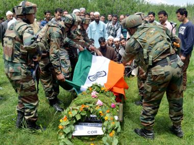 Army personnel paying tribute to Ummer Fayyaz at his village Sursanoo in Kulgam district on Wednesday. PTI