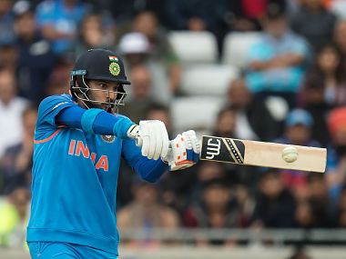 India's Yuvraj Singh hits a delivery for four during the ICC Champions trophy match between India and Pakistan at Edgbaston in Birmingham on June 4, 2017. / AFP PHOTO / OLI SCARFF / RESTRICTED TO EDITORIAL USE