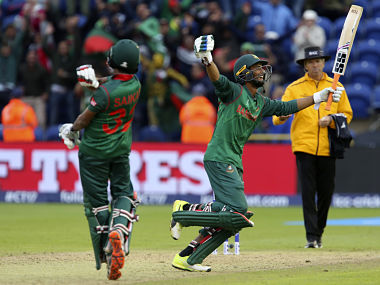 Bangladesh's Mahmudullah (R) celebrates their victory in the ICC Champions Trophy match between New Zealand and Bangladesh in Cardiff on June 9, 2017. Bangladesh beat New Zealand by five wickets in their Champions Trophy Group A match. / AFP PHOTO / Geoff CADDICK / RESTRICTED TO EDITORIAL USE