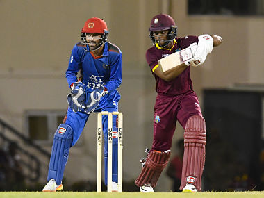 Shai Hope (R) of West Indies hits 4 during the 2nd ODI match between West Indies and Afghanistan at Darren Sammy National Cricket Stadium, Gros Islet, St. Lucia, June 11, 2017. / AFP PHOTO / Randy Brooks