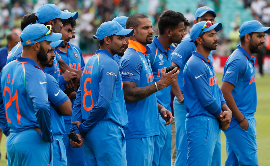 India's players look on as Pakistan team celebrated their win. Reuters