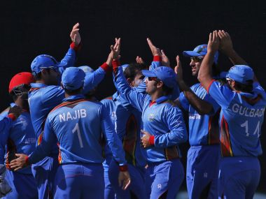 Cricket - England v Afghanistan - World Twenty20 cricket tournament - New Delhi, India, 23/03/2016. Afghanistan's players celebrate the dismissal of England's Jos Buttler. REUTERS/Adnan Abidi - RTSBUD2