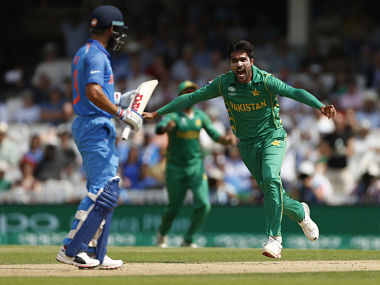 Mohammad Amir celebrates after taking the wicket of India's Virat Kohli in final of Champions Trophy . Reuters