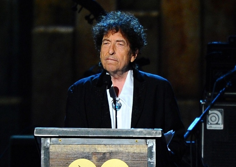 FILE - In this Feb. 6, 2015 file photo, Bob Dylan accepts the 2015 MusiCares Person of the Year award at the 2015 MusiCares Person of the Year show in Los Angeles. The Swedish Academy says it has received the required lecture from the 2016 Nobel Literature winner Bob Dylan, enabling the American singer-songwriter to collect 8 million Swedish kronor ($922,000) in prize money. (Photo by Vince Bucci/Invision/AP, File)