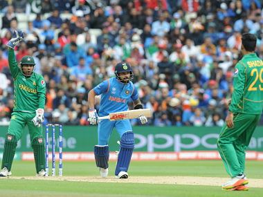 Indian cricket captain Virat Kohli takes a run during the ICC Champions Trophy match between India and Pakistan at Edgbaston in Birmingham, England, Sunday, June 4, 2017. (AP Photo/Rui Vieira)