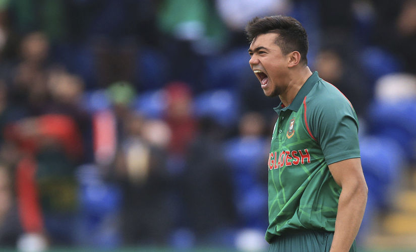 Bangladesh's Taskin Ahmed celebrates after taking the wicket of New Zealand's Luke Ronchi during the ICC Champions Trophy, Group A cricket match between New Zealand and Bangladesh, at Sophia Gardens, Cardiff, Wales, Friday June 9, 2017. (Nigel French/PA via AP)