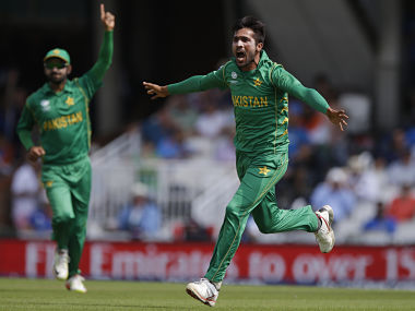 Pakistan bowler Mohammad Amir celebrates the dismissal of India's Shikhar Dhawan during the ICC Champions Trophy final at The Oval in London, Sunday, June 18, 2017. (AP Photo/Alastair Grant)