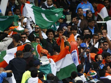 India and Pakistan fans fly flags during a rain break in their ICC Champions Trophy group B match at Edgbaston cricket ground in Birmingham, central England, June 15, 2013. REUTERS/Darren Staples (BRITAIN - Tags: SPORT CRICKET) - RTX10OKH