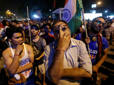 Fans in New Delhi watch India crumble against Pakistan in the Champions Trophy final. Reuters