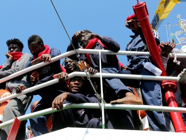 60 people missing feared drowned after boat sinks off Libya 80 survivors brought to safety in Italy