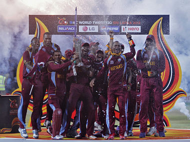 West Indies' players pose with the trophy after winning the World Twenty20 final cricket match against Sri Lanka in Colombo October 7, 2012. REUTERS/Dinuka Liyanawatte (SRI LANKA - Tags: SPORT CRICKET) - RTR38W6D
