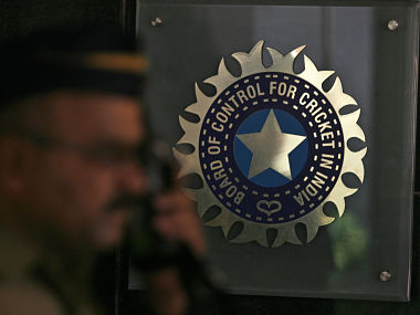 A policeman walks past a logo of the Board of Control for Cricket in India (BCCI) during a governing council meeting of the Indian Premier League (IPL) at BCCI headquarters in Mumbai April 26, 2010. Indian Premier League chief Lalit Modi has been suspended, officials said on Monday, after graft accusations in cricket's richest event ensnared top politicians and Bollywood stars and strained the ruling coalition. REUTERS/Arko Datta (INDIA - Tags: SPORT CRICKET) - RTXS5Z4