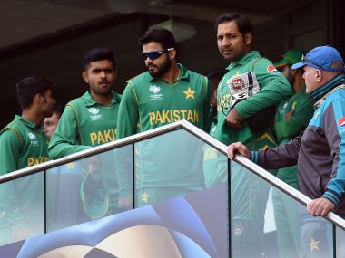 A disappointed Sarfraz Ahmed and his team during their match against India in the Champions Trophy. AFP