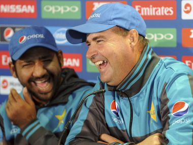Pakistan coach Mickey Arthur, right, attends a press conference with Pakistan captain Sarfraz Ahmed, left, ahead of their ICC Champions Trophy Group B match against India at Edgbaston in Birmingham, England, Saturday, June 3, 2017. (AP Photo/Rui Vieira)