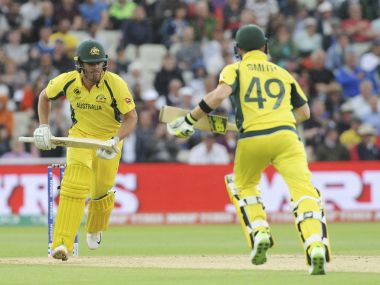 Australia's Moises Henriques, left, and Steve Smith run between wickets during the ICC Champions Trophy match between Australia and New Zealand at Edgbaston in Birmingham, England, Friday, June 2, 2017. (AP Photo/Rui Vieira)