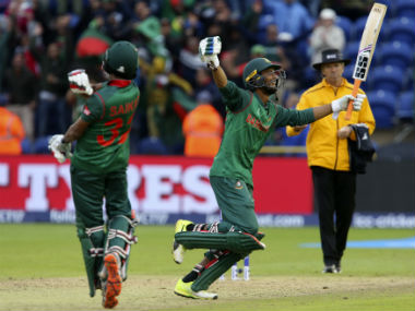 Mahmudullah (R) and Shakib Al Hasan celebrate Bangladesh's victory over New Zealand in the Champions Trophy in Cardiff. AFP