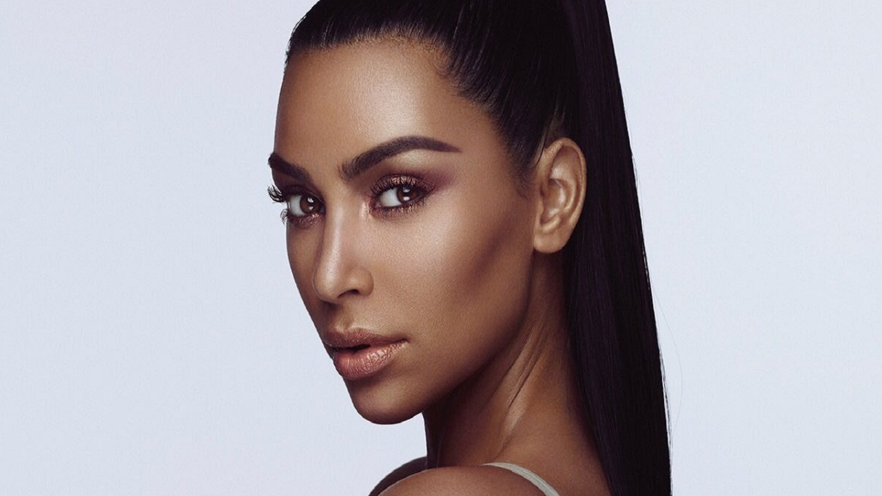 Kim Kardashian faces flak for posting image with 'darkened' skin tone to advertise her makeup line