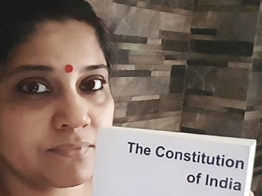 Renuka Shahane holds up the Constitution of India. Image from Facebook.