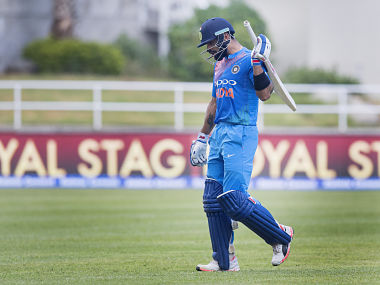 India's captain Virat Kohli walks off the pitch after getting dismissed in the first T20I. AFP