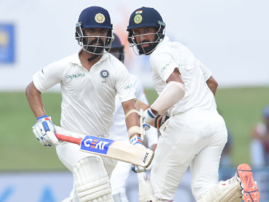 Indian batsmen Ajinkya Rahane (L) and Cheteshwar Pujara run between the wickets during the second day of the first Test match between Sri Lanka and India at Galle International Cricket Stadium in Galle on July 27, 2017. / AFP PHOTO / ISHARA S. KODIKARA