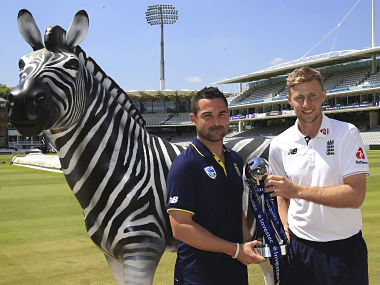England's cricket captain Joe Root, right, and South Africa's captain Dean Elgar pose with a trophy during the photocall at Lord's, cricket ground in London Wednesday July 5, 2017. England will play against South Africa in the first cricket Test match of the current series at Lord's starting Thursday. (Nigel French/PA via AP)
