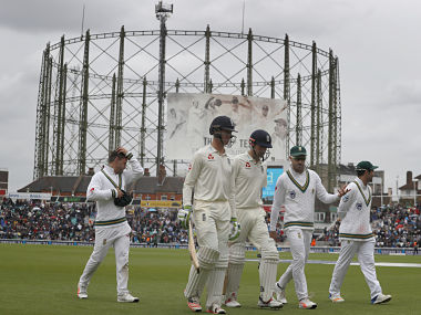 Players leave the pitch as rain forces an early lunch on the third day of the 3rd Test match between England and South Africa at The Oval. AP