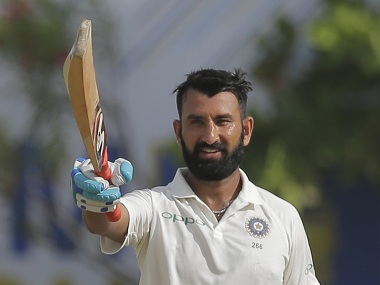 India's Cheteshwar Pujara celebrates scoring a century during the first day's play. AP