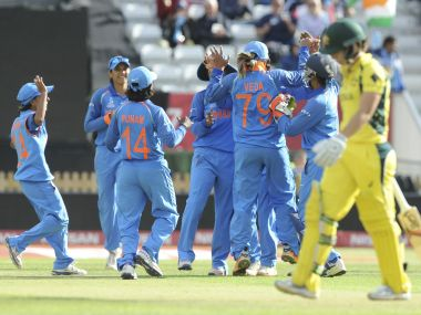 India teammates celebrate after dismissing Australia's Nicole Bolton during the semi-final. AP