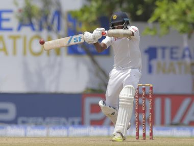 Sri Lanka's Dilruwan Perera in action against India in the first innings. AP