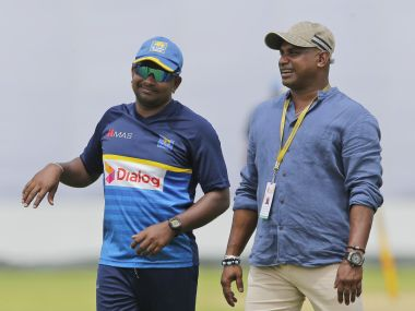 Sri Lanka's standing in test cricket captain Rangana Herath, left and chief selector Sanath Jayasuriya walk on the field during a training session ahead of the first test cricket match against India in Galle, Sri Lanka, Tuesday, July 25, 2017. (AP Photo/Eranga Jayawardena)