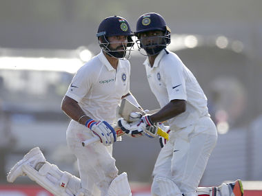 India's captain Virat Kohli and Abhinav Mukund run between the wicket during the third day of first Test. AP