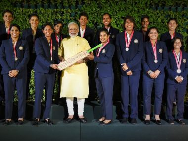 PM Narendra Modi with the Indian cricket team that took part in the ICC Women's World Cup 2017. Image courtesy: Twitter/@narendramodi