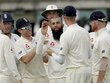 England's Moeen Ali holds up the ball to celebrate taking his fifth wicket of the innings during the first test at Lord's. AP