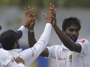 Sri Lankan bowler Nuwan Pradeep, right, celebrates after taking the wicket of India's Abhinav Mukund with team mates during the first day's play of the first test cricket match between India and Sri Lanka in Galle, Sri Lanka, Wednesday, July 26, 2017. (AP Photo/Eranga Jayawardena)