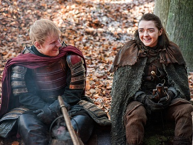 This image released by HBO shows Ed Sheeran, left, and Maisie Williams in a scene from Game of Thrones. Sheeran appeared as a Lannister soldier leading a group in song in the season premiere of the hit HBO fantasy drama, which debuted on the premium cable channel Sunday night. Image via AP