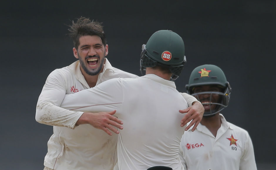 Zimbabwe's captain Graeme Cremer celebrates the dismissal of Sri Lanka's Angelo Mathews on the final day of their only test cricket match in Colombo, Sri Lanka. AP