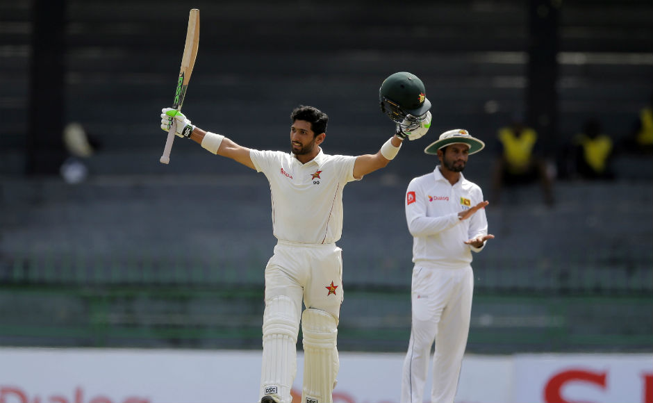 Zimbabwe's Sikandar Raza celebrates scoring a century during the fourth day. AP