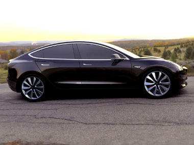 Musk hands over the Model 3 to first 30 buyers as Tesla forays into the electric car mass market