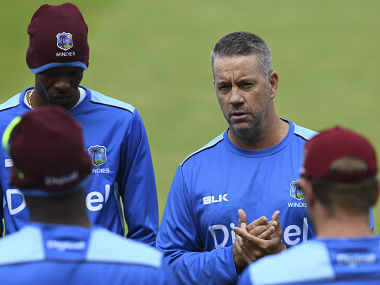 """West Indies coach Stuart Law (R) takes part in a training session on the eve of the first day of the first cricket Test Match between England and the West Indies at Edgbaston in Birmingham, central England on August 16, 2017. West Indies coach Stuart Law hopes his side can """"rewrite history"""" during a Test series in England. The first of a three-match campaign gets underway at Edgbaston on August 17 with the inaugural day/night Test ever staged in England. / AFP PHOTO / Paul ELLIS / RESTRICTED TO EDITORIAL USE"""