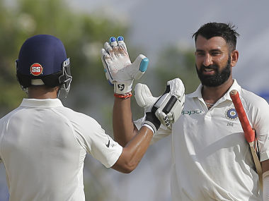 India's Cheteshwar Pujara celebrates with with Ajinkya Rahane after scoring his 13th Test century. AP