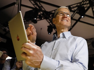 Apple CEO, Tim Cook holds an iPad Pro. Reuters